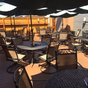 image of the patio at the Gardner Ale House with tables and chairs set up